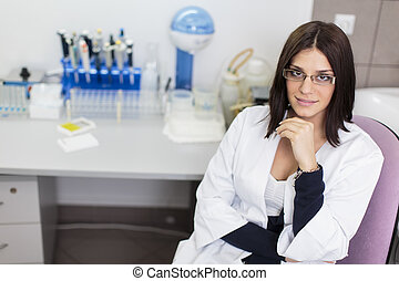 Young woman in modern medical laboratory