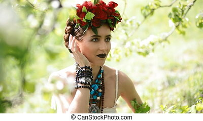 Young woman in national dress pose to photographer