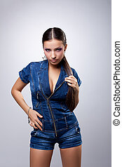 Young woman in overalls