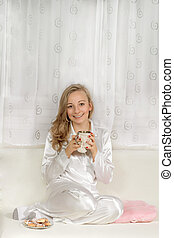 Young woman in pajamas With Hot Drink