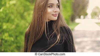 Young woman in park - Beautiful female with long hair...