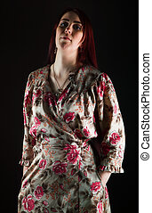Young woman in peignoir with red hair