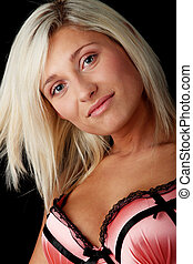 Young woman in pink ligerie isolated on black