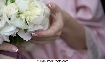 Young woman in pink lingerie with flowers bouquet slowmotion