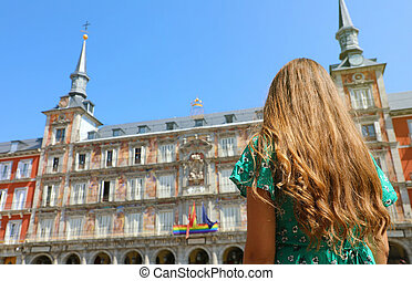 Young woman in Plaza Mayor square, Madrid, Spain