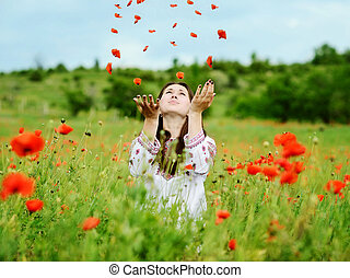 young woman in poppy field
