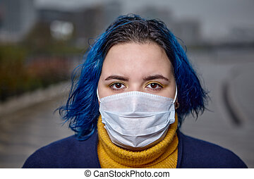 Young woman in protective medical mask from flu.