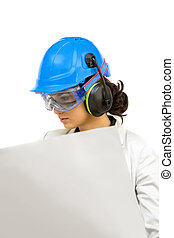 Young woman in protective workwear looking at blueprint