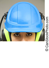 Young woman in protective workwear with blank board
