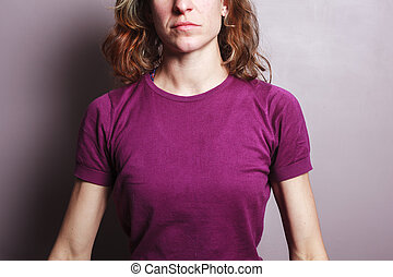 Young woman in purple top