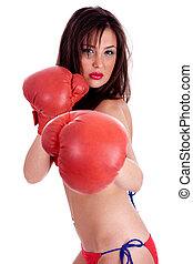 Young Woman in red bikini doing boxing excercise with red gloves, indoor studio over white background
