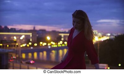 Young woman in red dress is sitting on a parapet - Gold time...