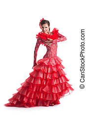 Young woman in red dress performing flamenco