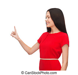 young woman in red dress pointing her finger