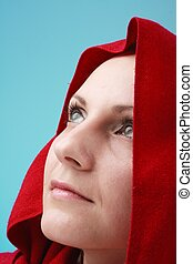 Young woman in red hood