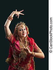 young woman in red rich oriental  indian costume