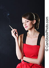 Young woman in red with cigarette