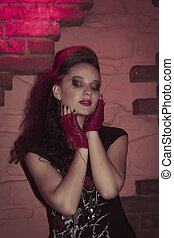 Young woman in rock style clothing. Studio shot