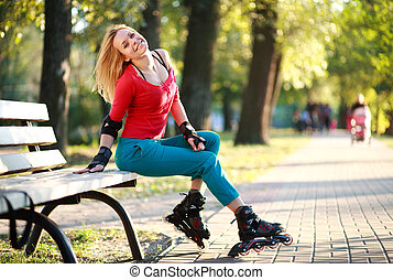 Young woman in roller skates
