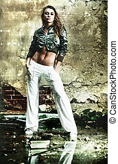 Young woman in ruined building. Contrast colors.