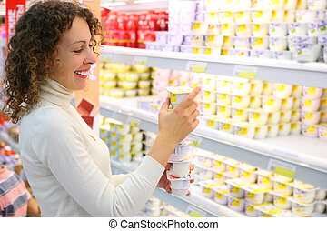 Young woman in shop - Young woman with yoghurt  in shop