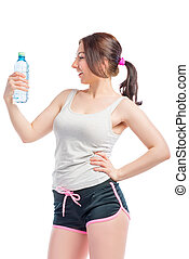 young woman in shorts and a t-shirt with a water bottle