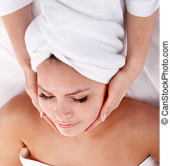 Young woman in spa. Facial massage.