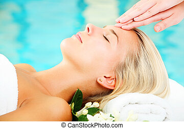 Young Woman In Spa - Young woman receiving professional...