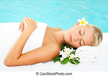 Young Woman In Spa - Young beautiful woman relaxing on a...