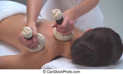 Young woman in spa. Traditional healing therapy and massaging treatments. Health and skin care, massage and recreation concept.