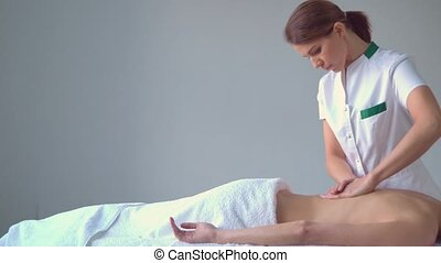 Young woman in spa. Traditional healing therapy and...