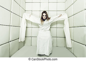 young woman in straitjacket