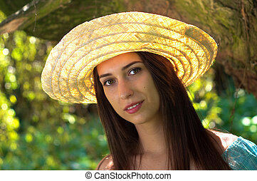 Young woman in straw hat