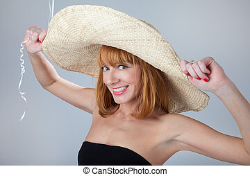 Young woman in straw hat.