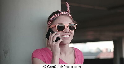 Young Woman In Sunglasses On Phone