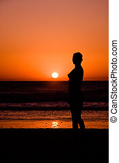 Young Woman in sunset