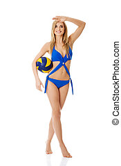 Young woman in swimsuit with a ball
