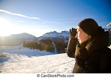 Young Woman In The Alps Mountains Looking Forward