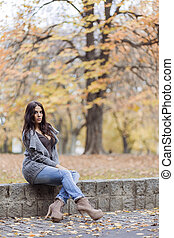 Young woman in the autumn park
