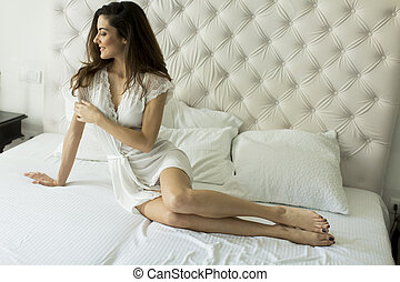 Young woman in the bed