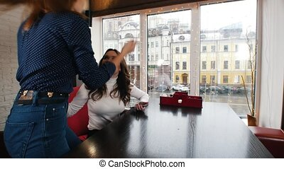 Young woman in the cafe waiting for her friends