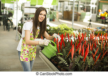 Young woman in the flower garden