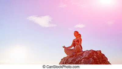 young woman in the lotus position