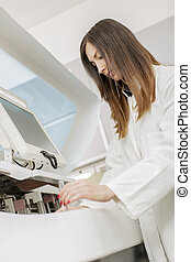 Young woman in the modern medical laboratory