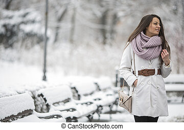 Young woman in the park at winter