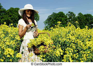 Young woman in the rape field