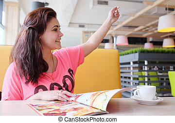 Young woman in the restaurant