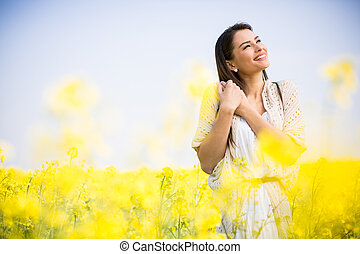 Young woman in the spring field