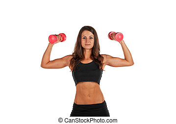 Young woman in the studio with weights