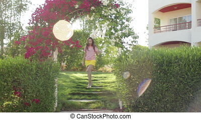 young woman in the summer on a background of beautiful exotic flowers